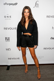Emily Ratajkowski teamed her suit with black ankle-tie sandals.