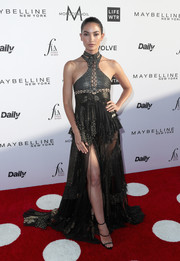 Lily Aldridge paired her dress with black triple-strap sandals by Giuseppe Zanotti.