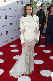 Kim Kardashian bared some skin, as always, in an embellished, sheer white gown by Givenchy Couture at the Fashion Los Angeles Awards.