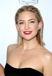 Kate Hudson made her lips the focal point with that  bright red color.