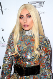 Lady Gaga attended the Fashion Los Angeles Awards wearing a shimmering frock, which she cinched in with an oversized black belt.