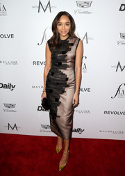 Ashley Madekwe was modern-chic at the Fashion Los Angeles Awards in a gold sheath dress with textured black detailing down one side.