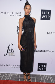 Lais Ribeiro sealed off her look with strappy black heels.