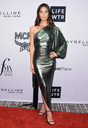Lily Aldridge sheathed her supermodel figure in a metallic-green one-sleeve gown by Alexandre Vauthier Couture for the Daily Front Row's Fashion Media Awards.
