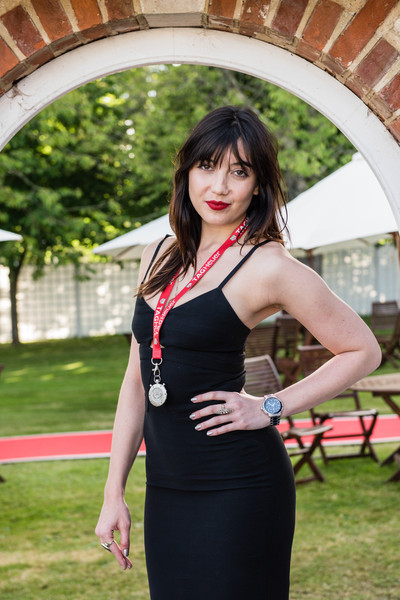Daisy Lowe Gold Chronograph Watch [photo,clothing,black,red,lady,dress,shoulder,beauty,model,fashion,photo shoot,daisy lowe,england,chichester,tag heuer,goodwood festival of speed]