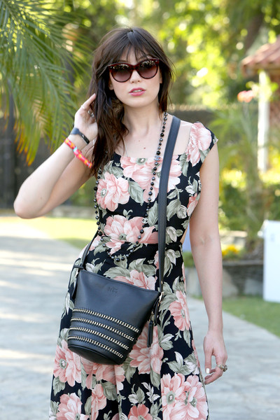 Daisy Lowe Cateye Sunglasses [street style,clothing,shoulder,eyewear,pink,dress,street fashion,fashion,lady,waist,joint,daisy lowe,coach handbag,the empire polo club,indio,california,coachella valley music and arts festival]