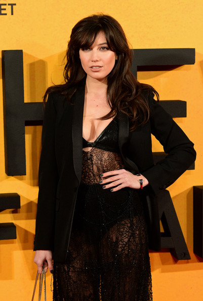 Daisy Lowe Dark Nail Polish [the wolf of wall street,clothing,suit,long hair,outerwear,little black dress,flooring,black hair,carpet,blazer,brown hair,daisy lowe,part,london,uk,england,odeon leicester square,premiere]