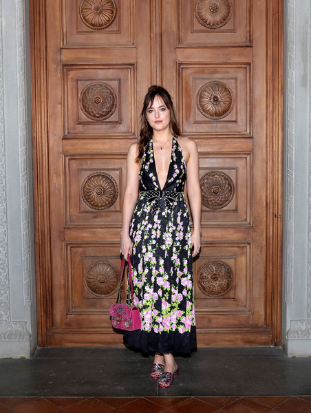 Dakota Johnson Chain Strap Bag [clothing,dress,beauty,lady,girl,fashion model,fashion,photo shoot,cocktail dress,flooring,cruise 2018 - arrivals,dakota johnson,palazzo pitti,florence,italy,gucci,fashion show,gucci cruise 2018]