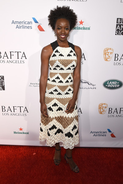 Danai Gurira Strappy Sandals [clothing,red carpet,dress,hairstyle,cocktail dress,shoulder,fashion,carpet,fashion design,fashion model,danai gurira,tea party,los angeles,four seasons hotel,california,beverly hills,bbca bafta]