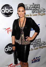 Tia Carrere layered a sequined back jacket over a leopard-print top for a totally fierce finish at the 'Dancing with the Stars: Live in Las Vegas.'