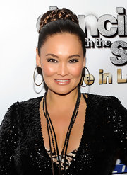 Tia Carrere topped off her busy ensemble at the 'Dancing with the Stars: Live in Las Vegas' with a pair of huge hoop earrings studded with tiny diamonds.