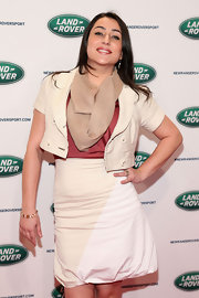 Jeannie Ortega sported a cream and nude bubble-style knee-length skirt while attending the unveiling of the new Range Rover.