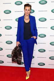 Yasmin Le Bon chose an electric blue pantsuit for her vibrant red carpet look.
