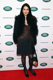 Yasmin Mills glammed it up with a cropped fur coat.