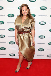 Jade Jagger sported a metallic gold cocktail dress with a belted waist for her appearance at the unveiling of the new Range Rover.