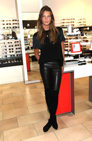 Daria Werbowy attended Fashion's NIght Out wearing a pair of leather pants and a fringe-sleeved tee.