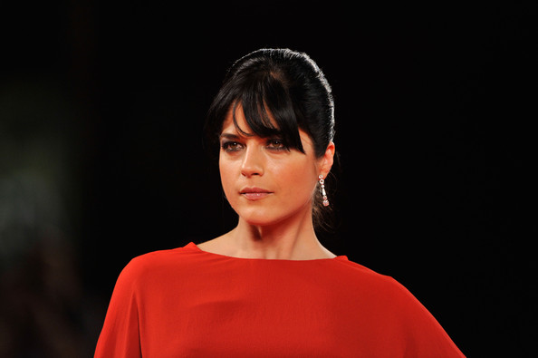Selma Blair arrived at the 'Dark Horse' premiere in Venice with a sleek updo and extra long bangs. Her hair was pinned back into a simple french twist and kept in place with a shine enhancing hairspray.