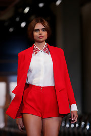 Samantha Harris showed off a pair of red dress shorts while walking the runway for David Jones in Australia.