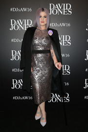 Kelly Osbourne shined in a metallic lavender lace dress by Rebecca Vallance, which she teamed with a black coat, during the David Jones fashion launch.