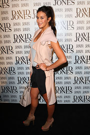 Megan pulled her hair back in a loose bin while attending the David Jones launch.