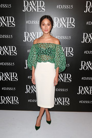 Nicole Warne chose a sleek white skirt to pair with her cute top.