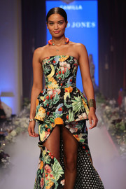 Shanina Shaik walked the David Jones runway show wearing a gold cuff and floral dress combo.