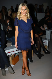 Mollie King accessorized her look with tan strappy sandals.