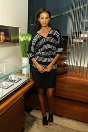Liya Kebede looked effortlessly stylish in a black-and-white striped kimono-style dress during her foundation's in-store benefit event.