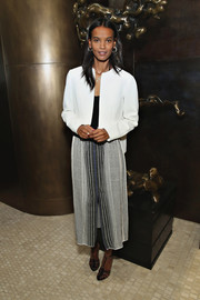 Liya Kebede teamed her jacket with a mixed-pattern skirt.