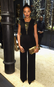 Selita Ebanks kept it trendy and classy in a black and gold jumpsuit during the David Yurman Soho boutique grand opening.