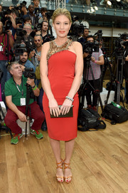Hofit Golan was rocker-glam at the Julien Macdonald fashion show in a red cocktail dress with a dangerous-looking spiked neckline.