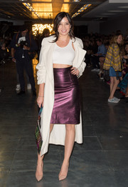 Daisy Lowe styled her top with an edgy-chic metallic purple pencil skirt.