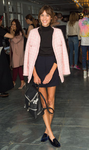 Alexa Chung dressed up a simple black turtleneck with a pink Chanel tweed jacket for the House of Holland fashion show.