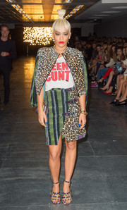Rita Ora worked a mixed-print skirt suit with a statement-making tee during the House of Holland fashion show.