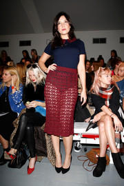 Daisy Lowe balanced out her sexy skirt with a conservative collared knit top.
