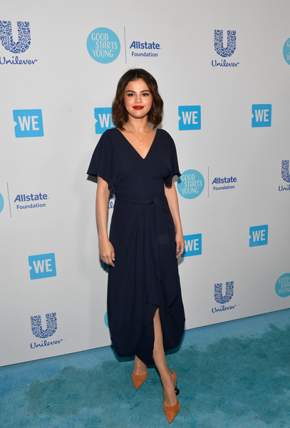 Selena Gomez looked airy in a navy bubble-hem midi dress by Jacquemus during WE Day California.