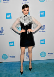 Sofia Carson caught eyes in a black Philosophy di Lorenzo Serafini leather dress with a contrast lace yoke and sleeves at WE Day California.