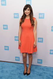 Hannah Simone opted for a simple orange dress when she attended the WE Day celebration dinner.