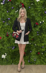 Laura Whitmore attended the Championships, Wimbledon carrying a checkered 'Love Me Tender' bag by Pinko.