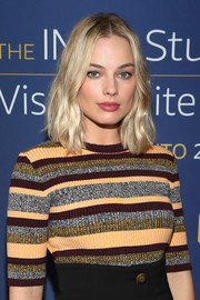 Margot Robbie sported a subtly wavy, center-parted hairstyle while visiting the IMDb Studio at the 2017 Toronto International Film Festival.