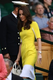 Kate Middleton was a drop of sunshine in this canary-yellow and white sheath dress by Roksanda Ilincic during the Wimbledon Championships.