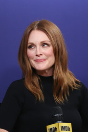 Julianne Moore wore a gently wavy, center-parted hairstyle at the IMDb Studio.
