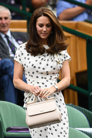 Kate Middleton accessorized with a cream-colored top-handle tote by Dolce & Gabbana at Wimbledon 2018.