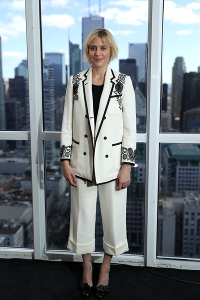 Greta Gerwig suited up in this embroidered white jacket and capri pants combo for her visit to the IMDb Studio.