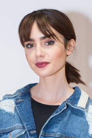 Lily Collins sported a ponytail with parted bangs while attending the opening of Beau Dunn's 'Plastic.'