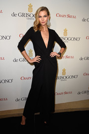 Karlie Kloss went for bold sophistication in a black gown with a deep-V plunge during the launch of the De Grisogono Crazy Skull watch.