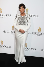 Kris Jenner arrived for the De Grisogono party wearing a long-sleeve white column dress with an embellished bodice.