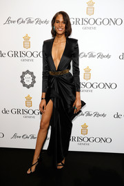Cindy Bruna showed major cleavage in this deep-V black gown by Redemption at the De Grisogono Love on the Rocks party.