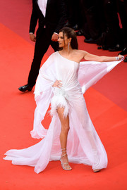 Alessandra Ambrosio styled her dress with sexy multi-strap sandals by Rene Caovilla.