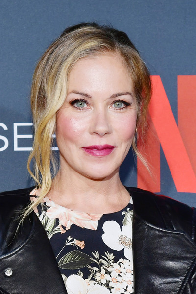 Christina Applegate styled her hair into a loose bun with wavy tendrils for the 'Dead to Me' FYC event.